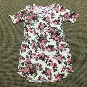 Knee length floral dress.